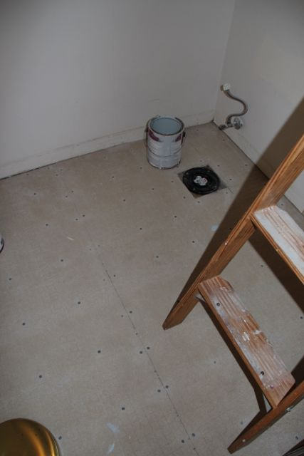 The newly installed cement board subfloor